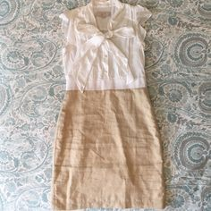 White and tan Ann Taylor LOFT 00 petite dress White and tan Ann Taylor LOFT 00 petite short sleeve dress. The top has three buttons and a built in cami so it is not shear. The bow on the front can be retied. The bottom is tan with gold shimmer. The dress has a zipper up the left side. Only worn a few times and in good condition. LOFT Dresses Midi