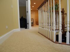 A beautiful hallway with an elegant trellis patterned carpet... another installation by Russell Martin Carpets