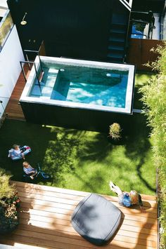 A raised plunge pool was a clever solution to saving space and removing the need for a pool fence. The timber decking and lush greenery is the perfect space to lounge in the sun. pool ideas A Paddington terrace received a modern luxe renovation Small Backyard Pools, Small Pools, Fire Pit Backyard, Backyard Seating, Backyard Decks, Small Pergola, Oberirdischer Pool, Pool Fence, Above Ground Pool