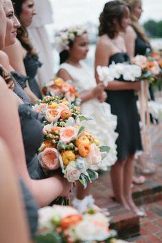 gray dresses, orange flowers