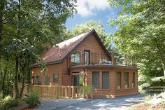 Greenleaf - This 1 bedroom cabin is pet friendly and is also minutes from the Great Smoky Mountains National Park! This cabin has a nice deck on both the front and side of the cabin in a beautiful wooded setting with tables and chairs. #gatlinburg #cabin #americanmountain