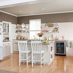 Classic Cottage - In a small kitchen, white works wonders to create the illusion of more space. Open shelving and beaded-board paneling are inexpensive ways to give any kitchen a cottage feel. A stripe of rich taupe paint gives the kitchen substance and ensures all the white doesn't feel washed out.