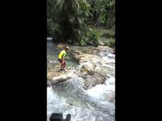 Parker Jax Ward at the top of Dunn's River Falls famous waterfalls in Oc...