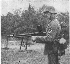 Captured ZB-26 light machine gun produced in Czechoslovakia in the 1920s is used by a German soldier