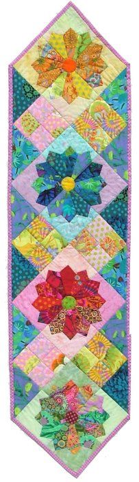 Dresden plate and four square table runner.  Kaffe Fassett fabric