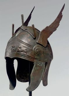 A GREEK BRONZE WINGED HELMET OF CHALCIDIAN TYPE | LATE CLASSICAL PERIOD, CIRCA 4TH CENTURY B.C.
