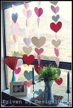 Extra decor. Do shape of cards symbol. Hearts, ace, clover , spade in glitter craft pastel colors. pink, blue, light yellow gold, mint green and shabby chic flower print. Hang on front of food and cake table or like this from window bar behind cake table.