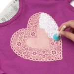 I did this on the front of Lorelei's Valentine's Day dress.  It really is easy and very pretty.