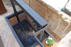 Want a BBQ pit in your outdoor kitchen? We can build and install it and make it look beautiful! By Outdoor Signature in Argyle, TX