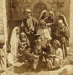 Palestinian Christian family, including orthodox priest in 1900, in Ramallah, Palestine.