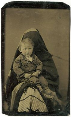 """Hidden Mother"" was a 19th century portrait trend where mothers, who were basically dressed a ""ghost,"" would hold their young children still while being photographed."