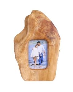 This solid driftwood picture frame has been treated and gloss finished creating a uniquely shaped frame.