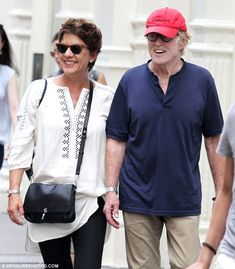 All smiles! Robert Redford and his wife of six years Sibylle Szaggars looked to still be i...