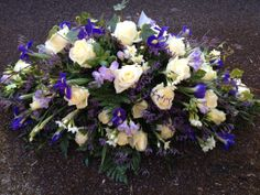 Double ended spray with iris, avalanche roses, narcissus, freesia, limonium, rosemary, myrtle & basil