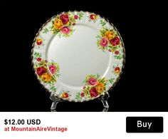 Salad/Dessert Plate Royal Staffordshire Bone China Bouquet   This beautiful bone china salad/dessert plate is made by Royal Staffordshire in the Bouquet pattern. The plate's rim is trimmed in gold. The floral design is set against a fluted edge. This plate would be a grand addition to your china collection, used as a serving piece, or just for display.   #plate #bonechina #royalstaffordshire #china #homedecor #dessert #salad #mountainairevintage