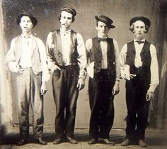 Henry McCarty (Billy The Kid), Doc Holiday, Jesse James & Carlie Bowdre.    Las Vegas, New Mexico 1879.    Billy & Doc were deputies of the law, and Jesse & Charlie were peace officers- which the white flag hanging from the pockets represented.