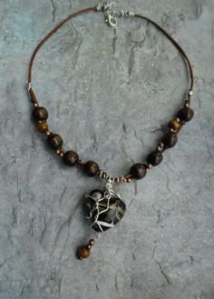 Homemade leather ladies necklace / leather straps / black heart shaped wire wrapped pendant by Liesbeth Visscher at JHFWBeadsAndFindings on #Etsy #jewelry #jewelery #jewellery #leather #straps #shopyourlove #wooden beads
