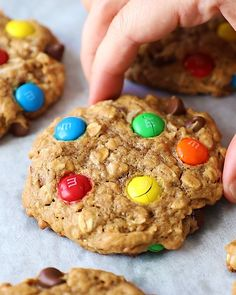 Incredible healthy monster cookies packed with peanut butter flavor, chocolate chips, coconut, chocolate candy pieces and nuts. These flourless monster cookies are a wholesome take on a childhood classic you know and love! Easy to make and great for customizing.