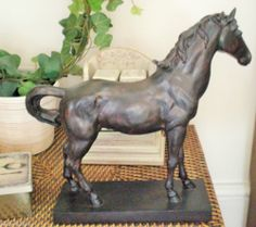 Sculpture of a beautiful horse  in cold cast bronze would look good in any room £34.99