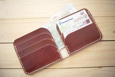 This dark brown vegetable tanned leather billfold wallet for minimalist by the features 6 slots. There handmade100% all of the production,