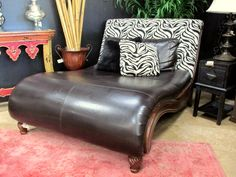 "Grand zebra fabric and leather chaise. This peace makes a statement in any space. Includes large full width leather back pillow and two accent pillows, one in matching zebra fabric and the other in matching leather. It also has wooden side accents and feet. Size O.A. 54"" w x 42"" H x 72"" deep. Original price $1695.00. Now just $849.00(price final and as is)."