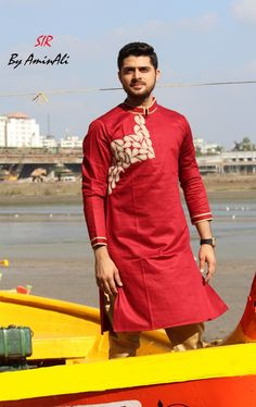 Mens Designer festive cotton pathani suit with collar neck, short button placket and full sleeves and curve hem. Comes with matching bottom. Mens Indian Wear, Mens Ethnic Wear, Indian Men Fashion, Mens Fashion Wear, Mens Shalwar Kameez, Kurta Men, Mens Kurta Designs, Kurti Designs Party Wear, Pathani For Men