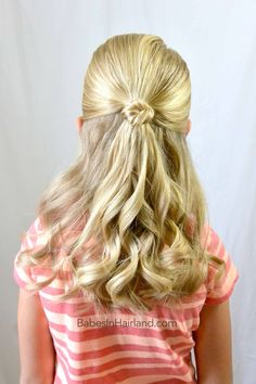 Add a cute knot to the top of any ponytail with this easy Knot Topped Ponytail from BabesInHairland.com #hair #hairstyle #knot #curls #easyhairstyle #ponytail