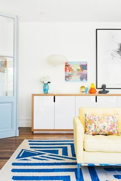 . Argentinian salvaged doors, sideboard designed by Meacham Nockles McQualter, Noguchi hanging light, small artwork by Kate Shaw (from Sullivan and Strumpf, Sydney) larger work Mira Gojak (Murray White Room), Knoll sofa. Photo - Brooke Holm, production – Lucy Feagins / The Design Files. #KBHome