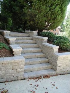 More formal appearing retaining wall with steps # Retaining Wall Steps, Landscaping Retaining Walls, Patio Steps, Front Yard Landscaping, Retaining Wall Gardens, Concrete Retaining Walls, Sloped Backyard, Backyard Patio, Landscape Stairs