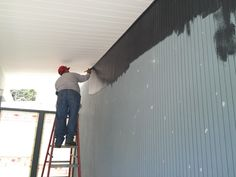 'Cutting in' the body area where the sprayer would risk getting too close to the ceiling.
