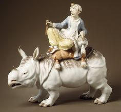 Turk on Rhinoceros  Ludwigsburg Porcelain Manufactory  Date: ca. 1755–60 Culture: German (Ludwigsburg) Medium: Hard-paste porcelain Dimensions: (.328a): H. 8-1/6 in. (20.7 cm.); L. 8-1/8 in. (20.6 cm.) (.328b): H. 1-3/4 in. (4.4 cm.); L. 9-5/8 in. (24.4 cm.)