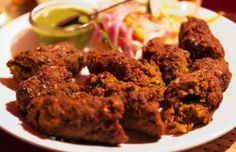 Mutton Seekh Kebab, made from minced spiced goat meet, molded onto the skewers and cooked in tandoor!! #Kebabs