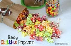 Skittles candy melted on popcorn taste just like the flavor color! So easy to make and super yummy! Popcorn Snacks, Candy Popcorn, Flavored Popcorn, Popcorn Bar, Popcorn Recipes, Candy Recipes, Sweet Recipes, Jello Popcorn, Popcorn Toppings