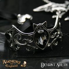 Alchemy Gothic A108 Viennese Nights Pewter Bracelet  A pewter bracelet in the form of an open, abstract, Baroque style bat with the body of a black diamond Swarovski crystal and fastened by a 7mm black satin ribbon with sliding pewter toggle.
