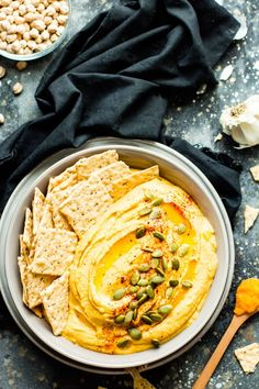 Savory Pumpkin Hummus gets a bit of a kick from a few special ingredients! This pumpkin hummus recipe makes an awesome Fall or Thanksgiving appetizer that is gluten-free, dairy-free, and vegan. Chutney, Vegan Gluten Free, Dairy Free, Vegan Vegetarian, Pumpkin Hummus, Pumpkin Dip, Healthy Pumpkin, Pumpkin Recipes, Thanksgiving Appetizers
