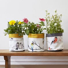 Handmade storage and plant pots made from 100% cotton and twill.Our storage and plant pots are available in a variety of designs across our three collections including: Bloom Collection: Broom & Bee, Greenfinch, Long Tailed Tit Songbird Collection: Juneberry & Bird, Willow Tit, Bullfinch Coast & Countryside: Flock, BradburyOur waterproof fabric plant and storage pots are a great way to bring some colour into your homes. Either in the kitchen filled with scented herbs or along the...