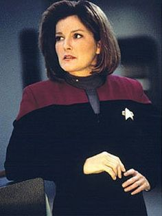 Captain Katherine M Janeway Commander USS VOYAGER NCC 74656 (intrepid class) which was abducted  from the area of space known as the BRIAR PATCH by the entity called  the CARE TAKER where they were stranded  75,000 light years (150 years travel time at maximum warp) from their ALPHA QUADRANT home after an arduous ODYSSEY Captain JANEWAY safely Shepherded her ship and surviving crew safely home to EARTH. signed Mr Skratch