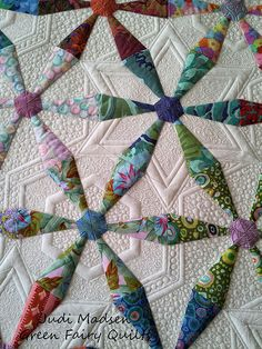 Spring Wheels quilted by Judi Madsen of Green Fairy Quilts.  Oh my word!  I love this!