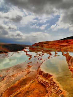 Badab-e Surt, Iran. Photo by Abbas Arabzadeh. A range of stepped travertine terrace formations, created over thousands of years as flowing water from mineral hot springs cooled and deposited carbonate minerals on the mountain side.