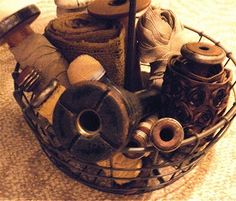 love old wooden spools and bobbins especially in old metal baskets