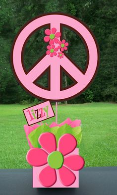 Large peace signs and flowers from foam