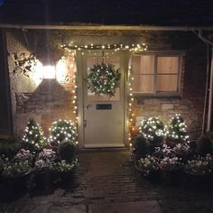 As you know, I love a fairy light, so I'm ramping up the light quota around the door. But now I'm wondering if it looks a little pub-like. Christmas Fairy Lights, Christmas Front Doors, Christmas Lanterns, Christmas Decorations, Holiday Decor, House With Porch, House Front, Cozy House, Country Christmas
