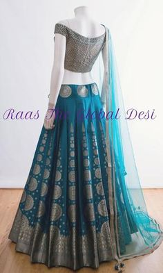BRIDAL LEHENGA ONLINE You will find different rumors about the real history of the wedding dress; Indian Fashion Dresses, Indian Bridal Outfits, Indian Gowns Dresses, Dress Indian Style, Indian Designer Outfits, Indian Wedding Dresses, Half Saree Designs, Choli Designs, Lehenga Designs