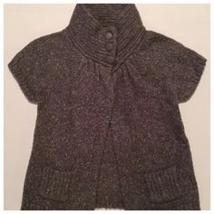 """Etam swing cardigan wool blend Please note that item is tagged as UK size 10. As a woman who generally wears size small, I believe this best fits US size small.  Sweater is a little lighter than it appears in picture. It is primarily gray with white marbled throughout the knit.  Condition: Minor fuzz. Bottom button is loose.  Armpit to armpit: 16"""" Shoulder to hem: 20"""" Smoke free, ferret friendly home *NO TRADES **NO MERCARI OR PAYPAL ***I DO NOT MODEL CLOTHING Etam Sweaters Cardigans"""