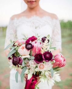 Bold wedding bouquet idea - red and burgundy wedding bouquet with proteas and ranunculuses {The Lees Photography} Bold wedding bouquet idea - red and burgundy wedding bouquet with proteas and ranunculuses {The Lees Photography} Bridal Bouquet Pink, Fall Wedding Bouquets, Wedding Flower Arrangements, Bride Bouquets, Bridesmaid Bouquet, Wedding Flowers, Wedding Dress, Bouquet Images, Austin Wedding Venues