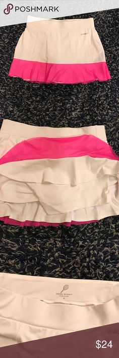 Pink and white tennis skirt Adorable pink and white tennis skirt. Bottom had pink mesh over white ruffle. Worn twice. Still bright white. Attached shorts underneath. Bebe Sport Skirts Mini