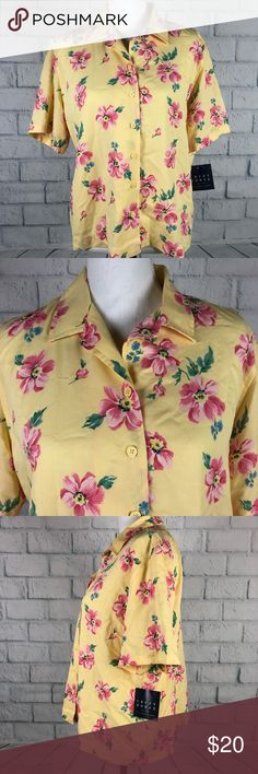 Crazy Horse floral top large NWT Crazy Horse Women Top Size Large Liz Claiborne Yellow Floral NWT #W32PM  Approx. Flat Lay Measurements:  Pit to pit: 22'  Arm: 10'  Back neckline to bottom: 23'  Items may appear brighter, lighter, or darker in the pictures due to photography lighting and camera.  Email with questions.  Thanks for looking! Liz Claiborne Tops Button Down Shirts