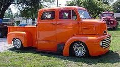 sweet 4 door orange C.O.E. Cab over Engine truck