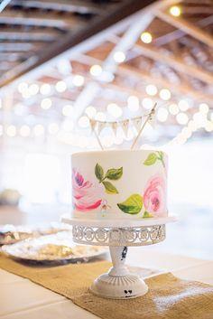 Hand painted wedding cake by Celebrity Cake Studio