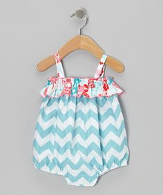 Charming with chevrons, this one-piece is footloose and fancy-free with its billowy silhouette, stretchy straps and contrast pattern ruffle up top.100% cottonMachine wash; tumble dryMade in the USA